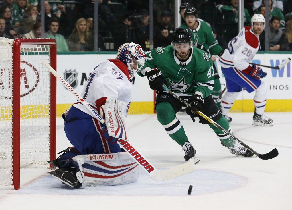 Montreal Canadiens goaltender Antti Niemi (37) makes a save as Dallas Stars right wing Alexander Radulov (47) watches the rebound during the first per
