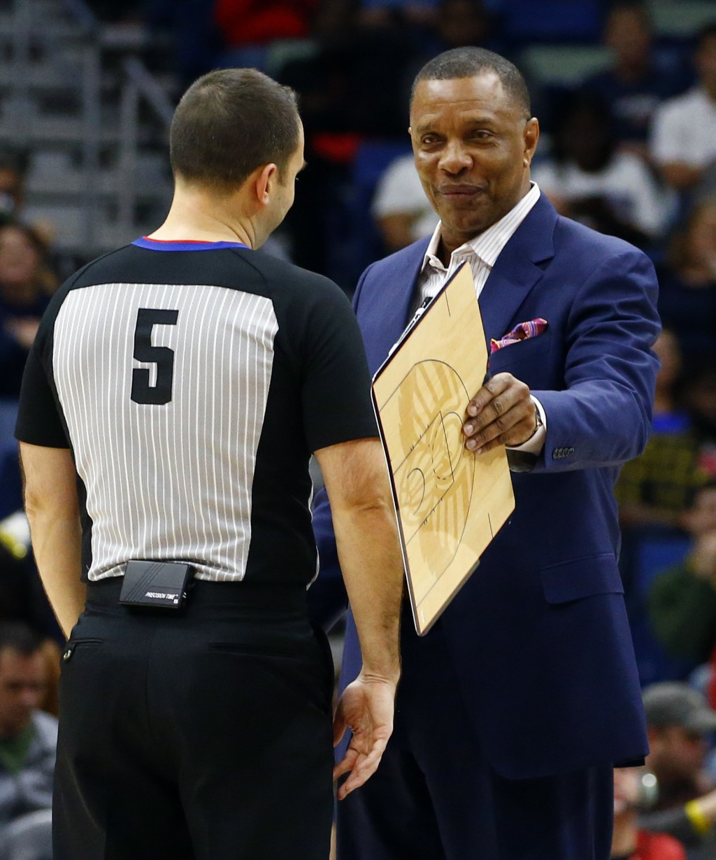 New Orleans Pelicans head coach Alvin Gentry, right, talks with referee Kane Fitzgerald (5) during the first half of an NBA basketball game, Monday, D