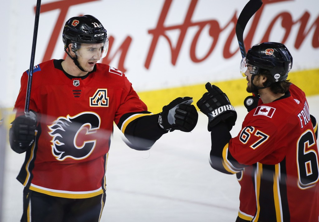 Calgary Flames' Mikael Backlund, left, of Sweden, celebrates his second goal against the San Jose Sharks with teammate Michael Frolik, of the Czech Re