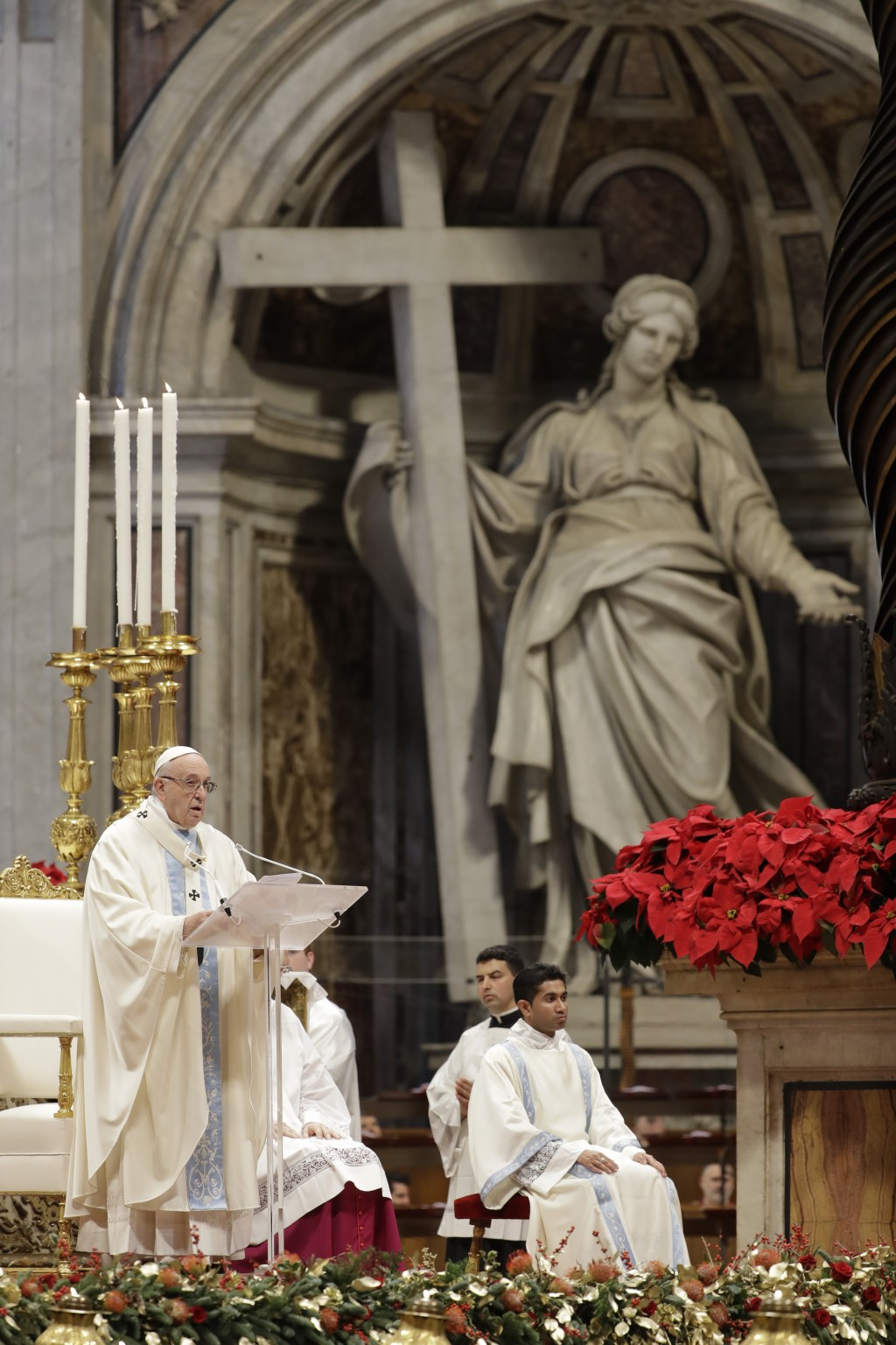 Pope Francis delivers his message as he celebrates a new year Mass in St. Peter's Basilica at the Vatican, Tuesday, Jan. 1, 2019. (AP Photo/Andrew Med...