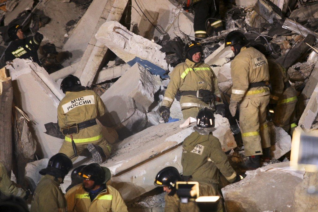 Emergency Situations employees working at the scene of a collapsed apartment building in Magnitogorsk, a city of 400,000 people, about 1,400 kilometer...