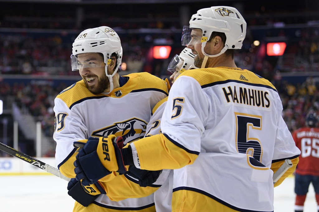 Nashville Predators center Frederick Gaudreau, left, celebrates his goal with defenseman Dan Hamhuis (5) during the second period of an NHL hockey gam