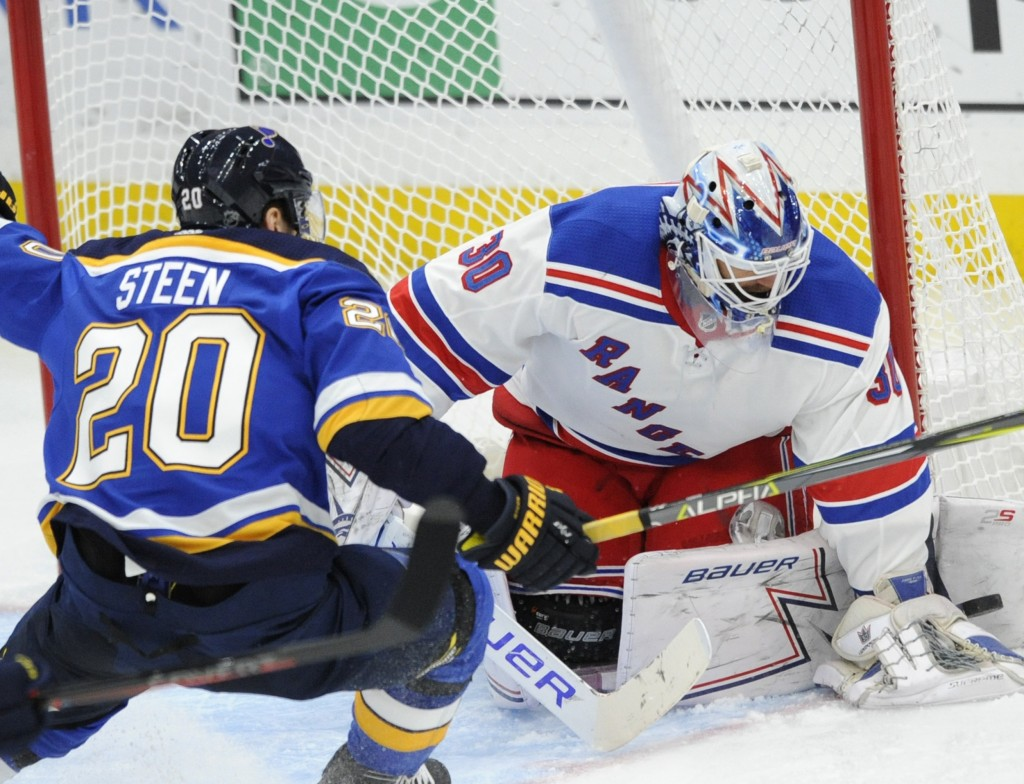 New York Rangers goalie Henrik Lundqvist (30), of Sweden, blocks a shot by St. Louis Blues' Alexander Steen (20) during the second period of an NHL ho
