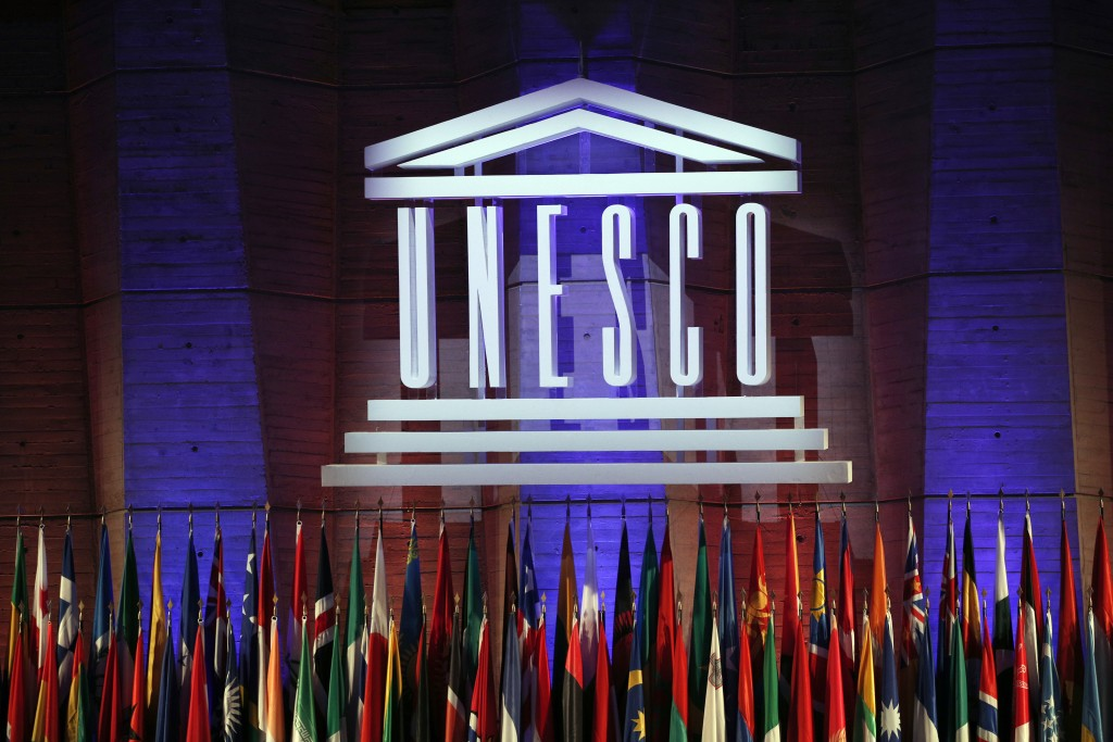 FILE - In this Saturday, Nov. 4, 2017 file photo, the logo of the United Nations Educational, Scientific and Cultural Organisation (UNESCO) is seen du...