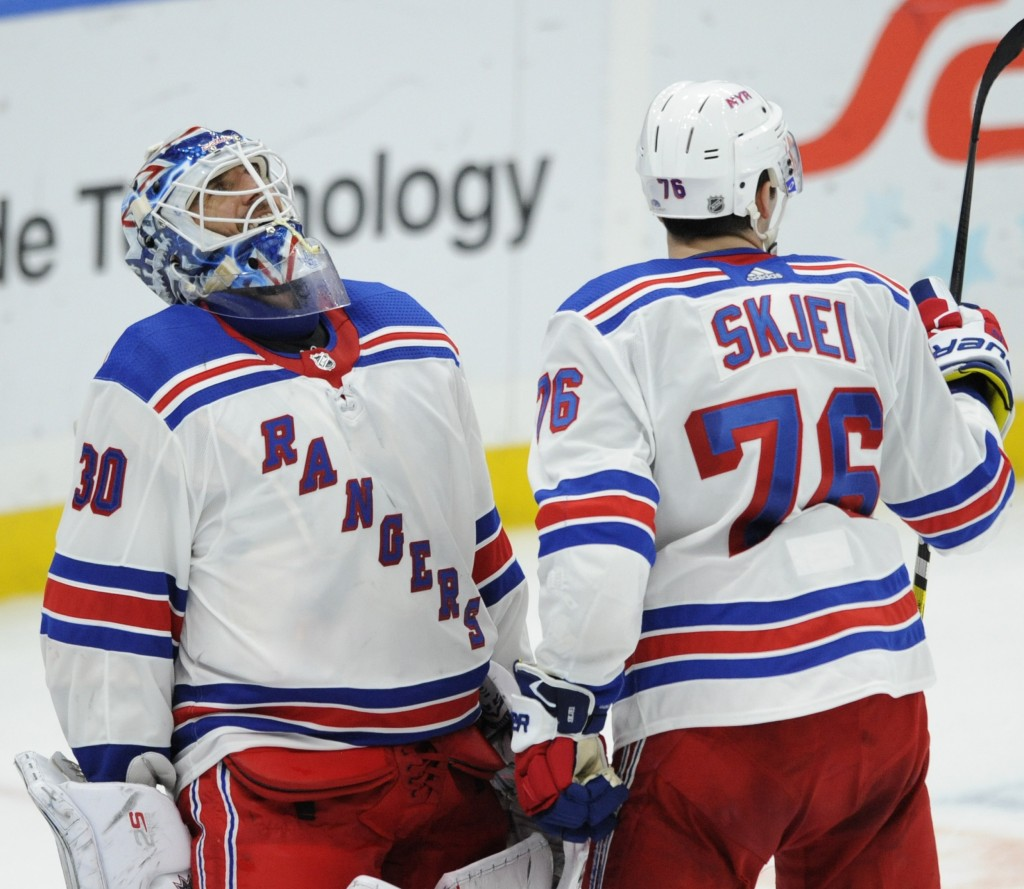 New York Rangers goalie Henrik Lundqvist (30), of Sweden, reacts with Brady Skjei (76) after the team's 2-1 victory over the St. Louis Blues in an NHL