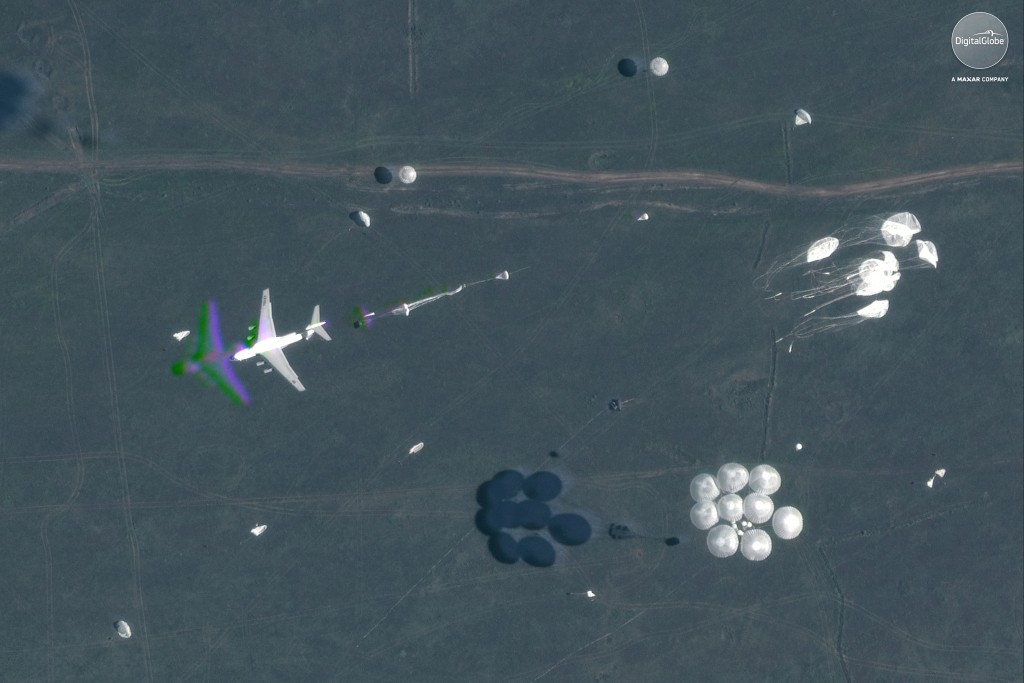 This Sept. 13, 2018 satellite image provided by DigitalGlobe shows an airborne paradrop during the Vostok military exercises in the Eastern Siberia ar