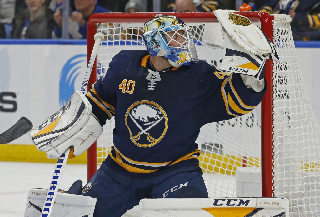 Buffalo Sabres goalie Carter Hutton (40) makes a save during the second period of an NHL hockey game against the New York Islanders, Monday, Dec. 31, ...