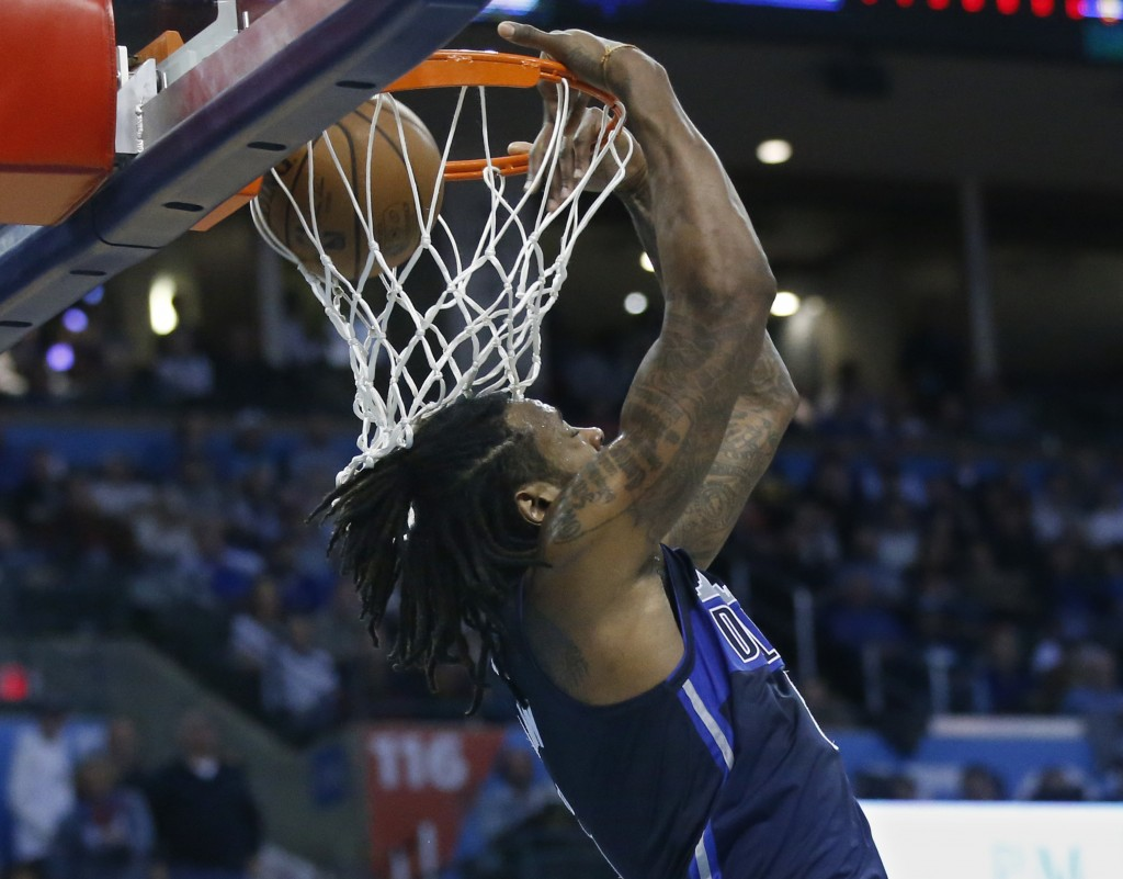 Dallas Mavericks center DeAndre Jordan dunks in the first half of an NBA basketball game against the Oklahoma City Thunder in Oklahoma City, Monday, D