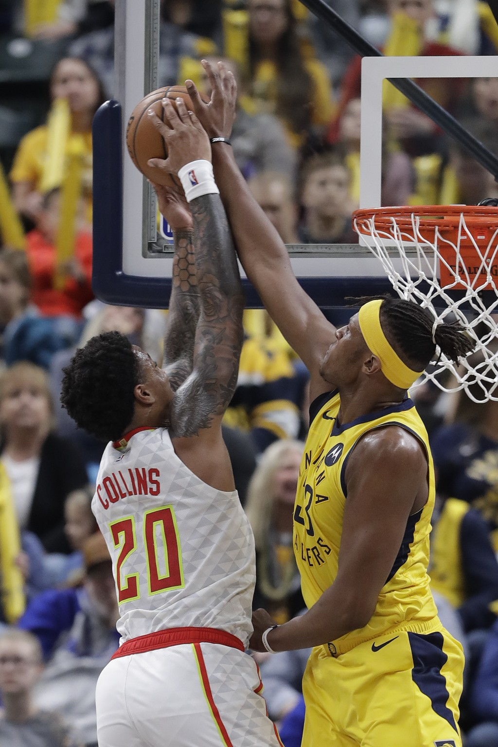 Atlanta Hawks' John Collins (20) goes up for a dunk against Indiana Pacers' Myles Turner (33) during the second half of an NBA basketball game, Monday...