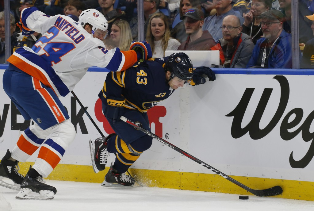 Buffalo Sabres forward Conor Sheary (43) skates past New York Islanders defenseman Scott Mayfield (24) during the first period of an NHL hockey game, ...