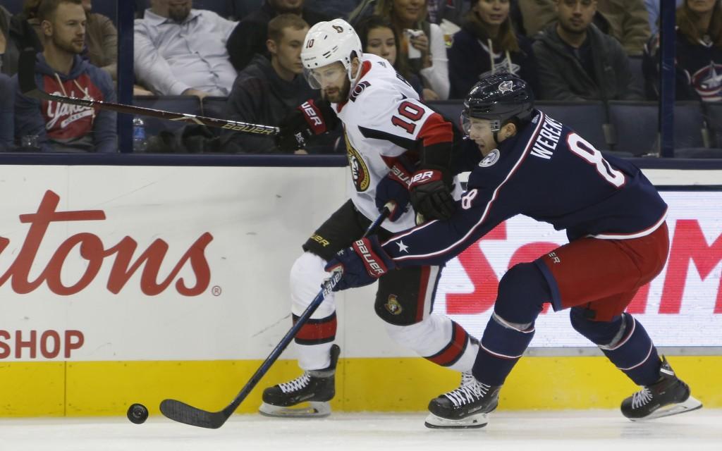 Ottawa Senators' Tom Pyatt, left, and Columbus Blue Jackets' Zach Werenski chase the puck during the first period of an NHL hockey game Monday, Dec. 3...