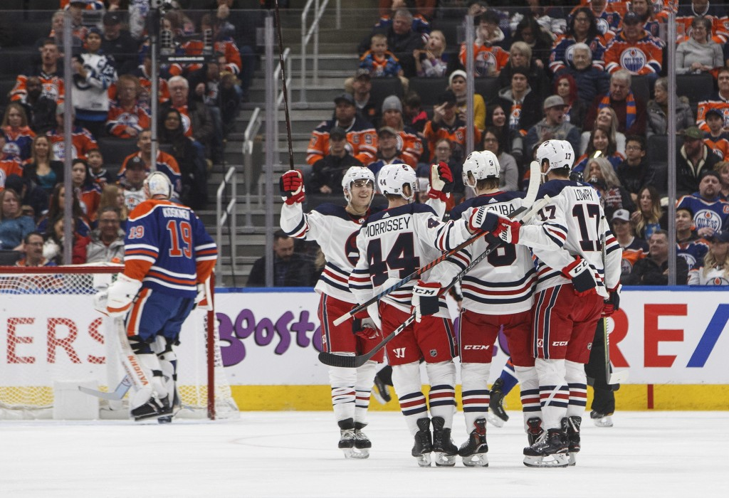 Winnipeg Jets celebrate a goal against the Edmonton Oilers during second-period NHL hockey game action in Edmonton, Alberta, Monday, Dec. 31, 2018. (J...