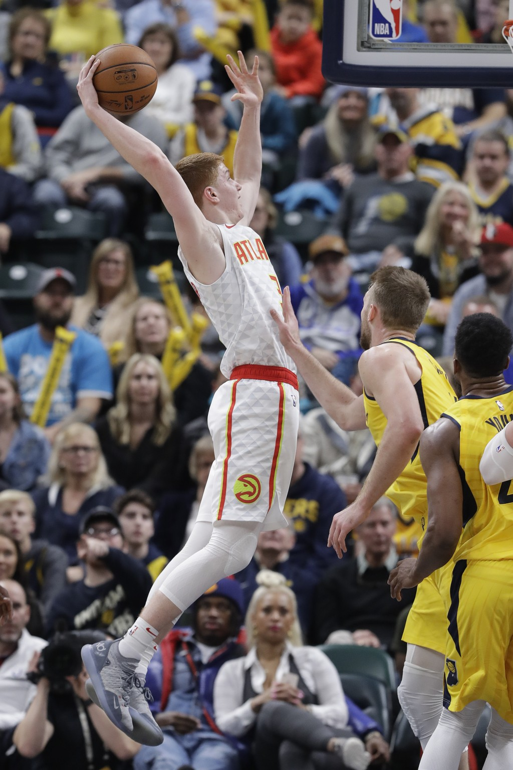 Atlanta Hawks' Kevin Huerter (3) goes up for a dunk against Indiana Pacers' Domantas Sabonis (11) during the second half of an NBA basketball game, Mo...