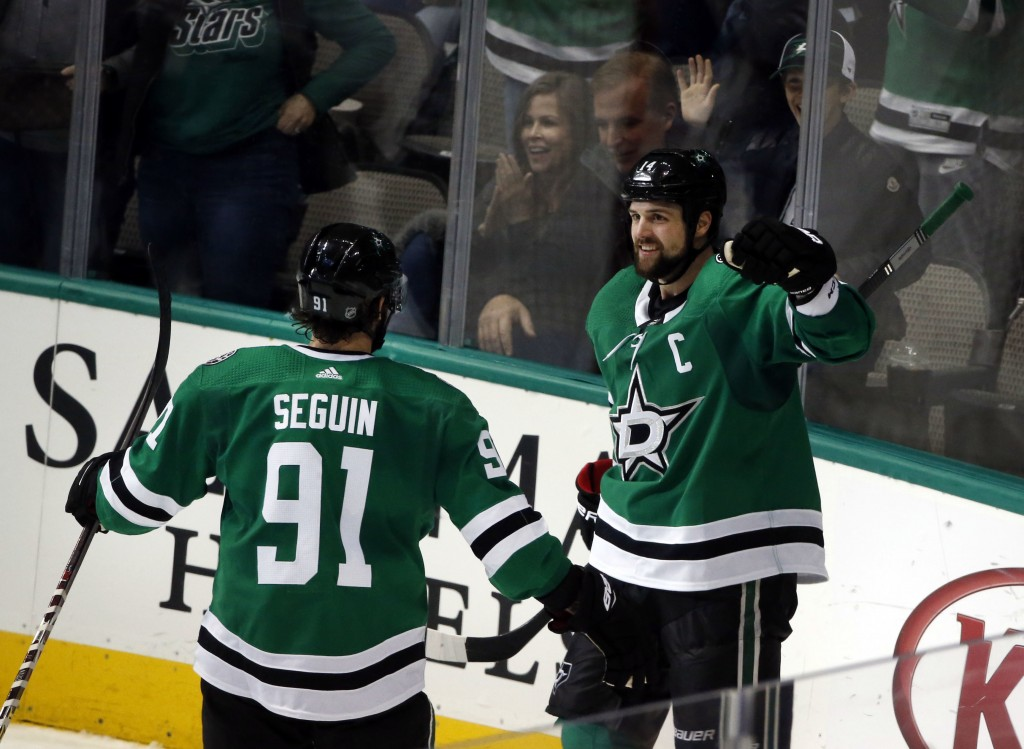 Dallas Stars left wing Jamie Benn, right, celebrates his goal with Stars center Tyler Seguin (91) against the Montreal Canadiens during the second per