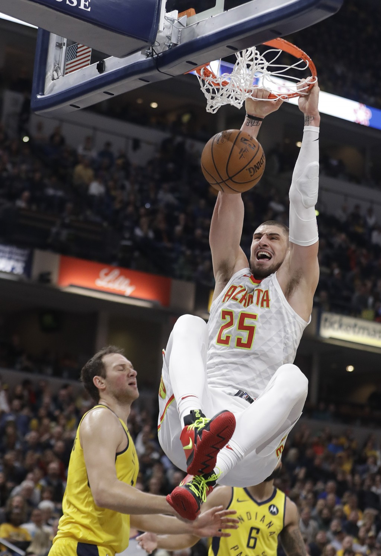Atlanta Hawks' Alex Len (25) dunks against Indiana Pacers' Bojan Bogdanovic, left, during the first half of an NBA basketball game, Monday, Dec. 31, 2...