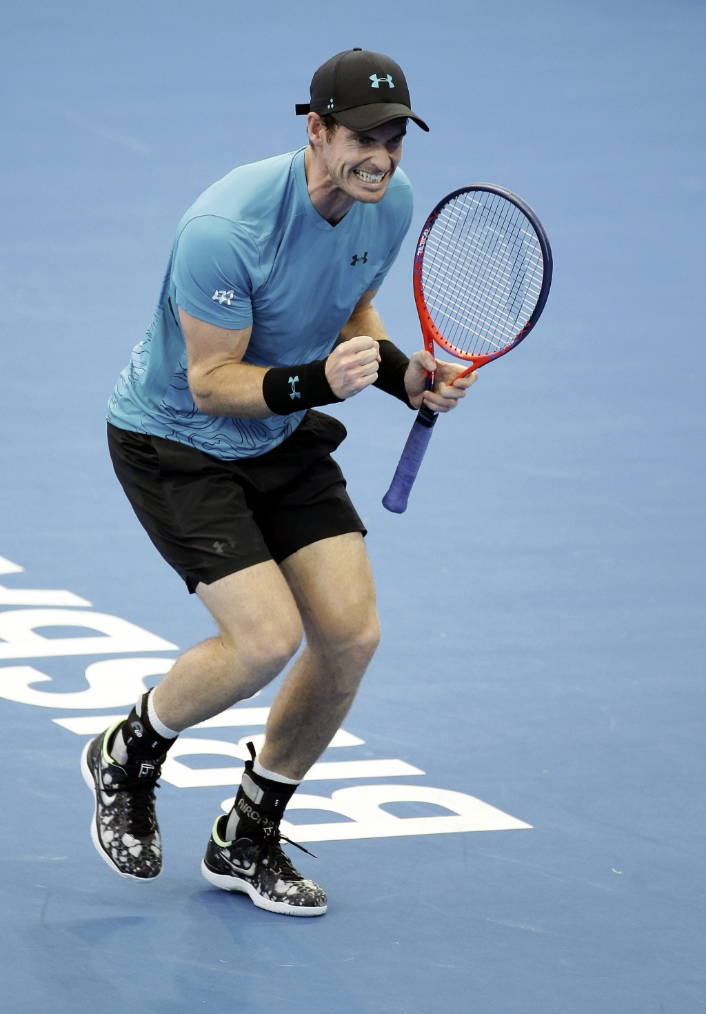 Andy Murray of Britain reacts after winning his match against James Duckworth of Australia at the Brisbane International tennis tournament in Brisbane...