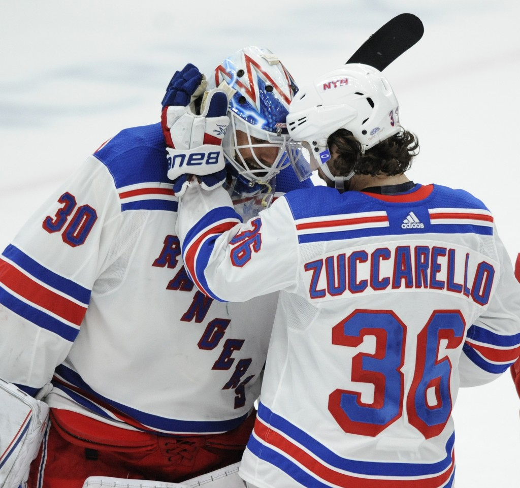 New York Rangers goalie Henrik Lundqvist (30), of Sweden, is congratulated by Mats Zuccarello (36), of Norway, after the team's 2-1 victory over the S