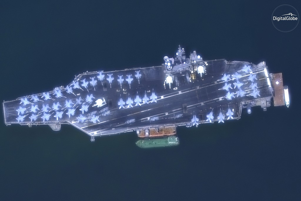 This March 6, 2018 satellite image provided by DigitalGlobe shows The USS Carl Vinson off the coast of Danang, Vietnam. (DigitalGlobe, a Maxar company