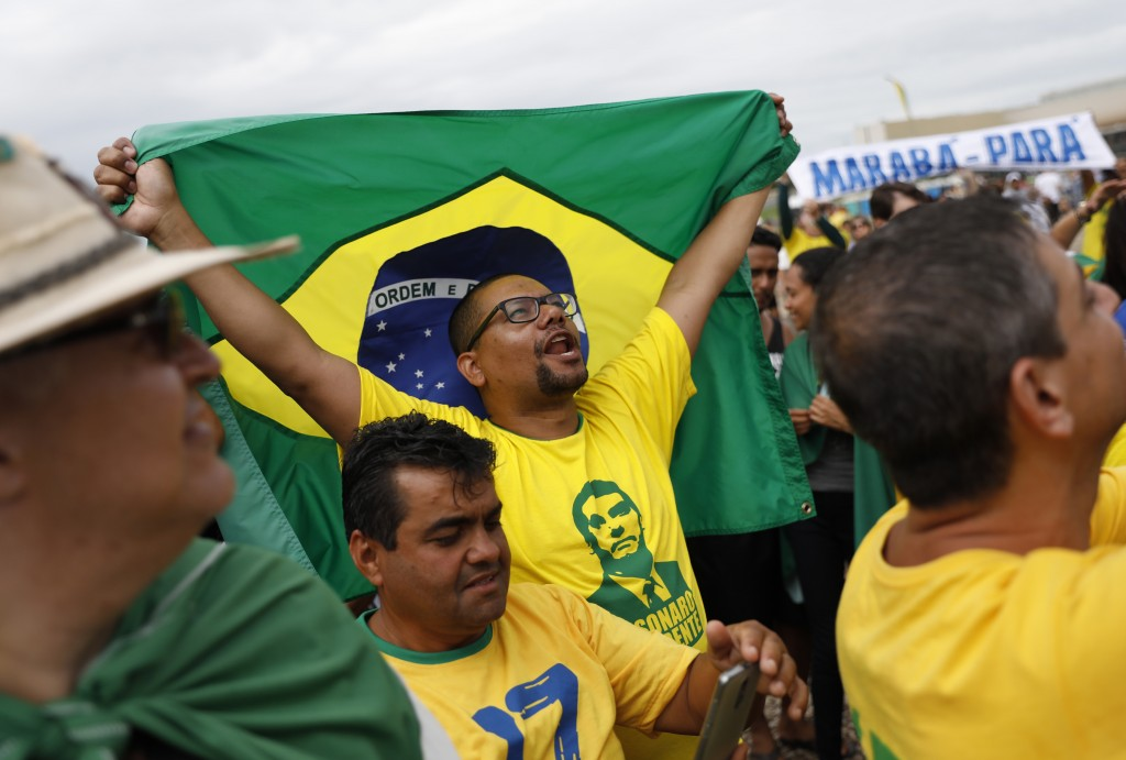 People celebrate before the swearing-in ceremony of Brazil's new President Jair Bolsonaro, in front of the Planalto palace in Brasilia, Brazil, Tuesda...