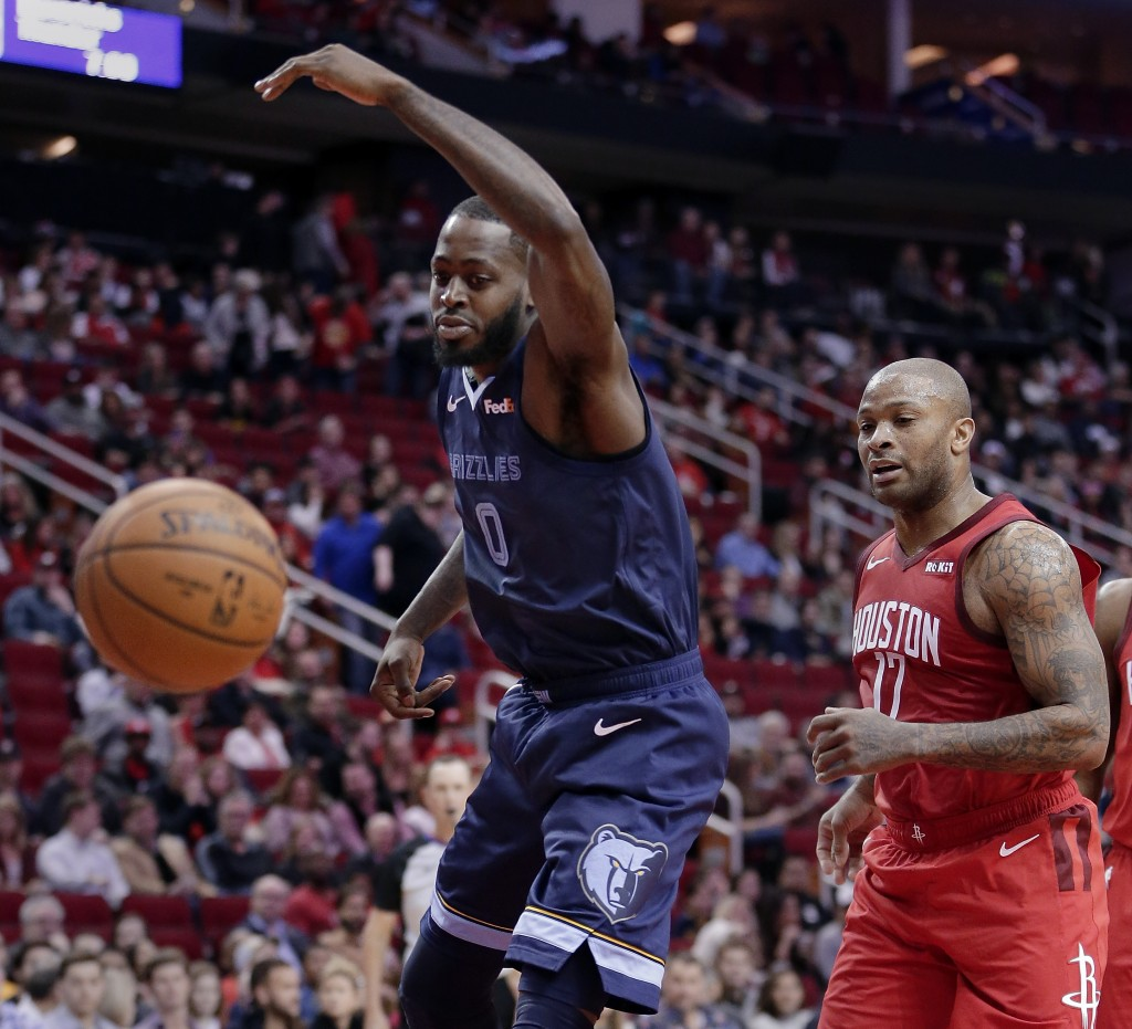 Memphis Grizzlies forward JaMychal Green (0) loses the ball on a drive to the basket in front of Houston Rockets forward PJ Tucker (17) during the fir