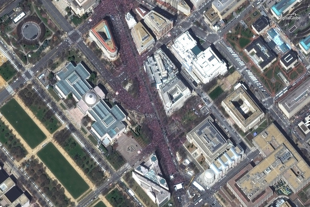 """This March 24, 2018 satellite image provided by DigitalGlobe shows crowds at the """"March for Our Lives"""" demonstration in Washington. (DigitalGlobe, a M"""