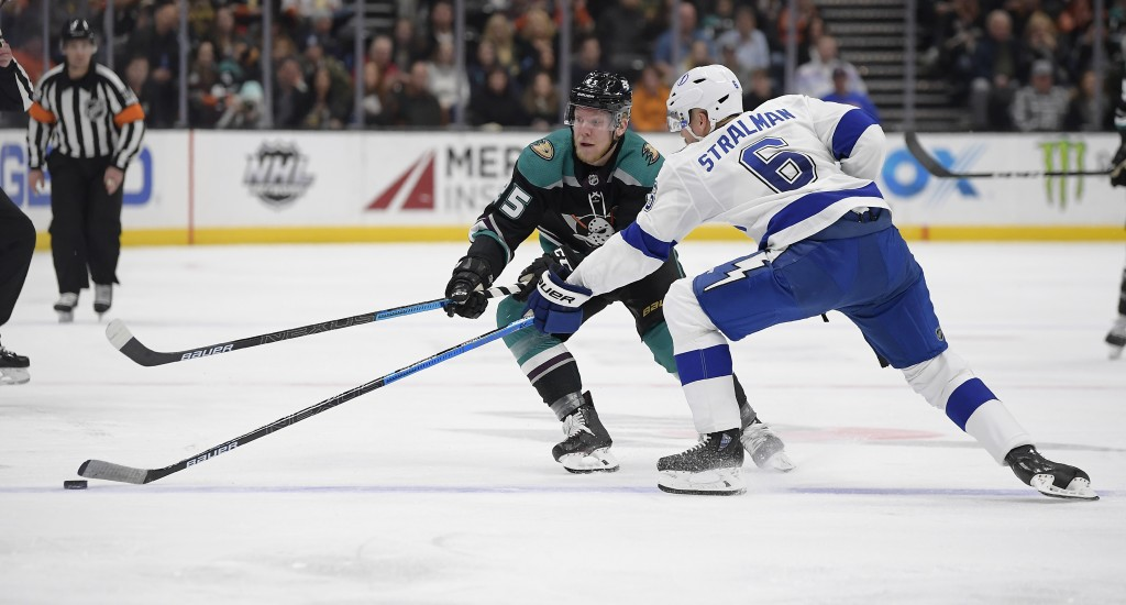 Anaheim Ducks right wing Ondrej Kase, left, and Tampa Bay Lightning defenseman Anton Stralman reach for the puck during the second period of an NHL ho