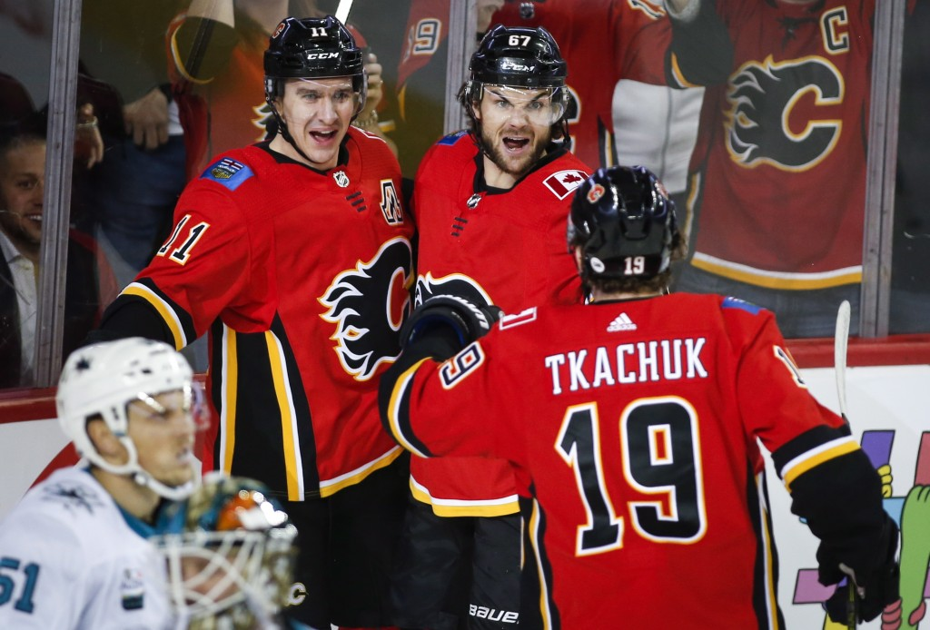 Calgary Flames' Mikael Backlund, left, of Sweden, celebrates his goal against the San Jose Sharks with teammates Michael Frolik, center, of the Czech