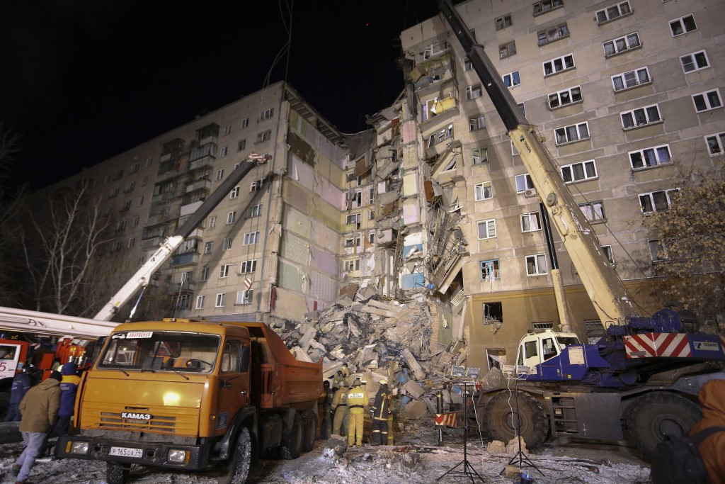 Emergency Situations employees working at the scene of a collapsed apartment building in Magnitogorsk, a city of 400,000 people, about 1,400 kilometer