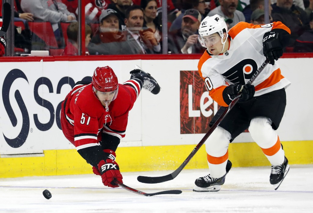 Carolina Hurricanes' Trevor van Riemsdyk (57) dives to tip the puck away from Philadelphia Flyers' Jordan Weal (40) during the second period of an NHL...