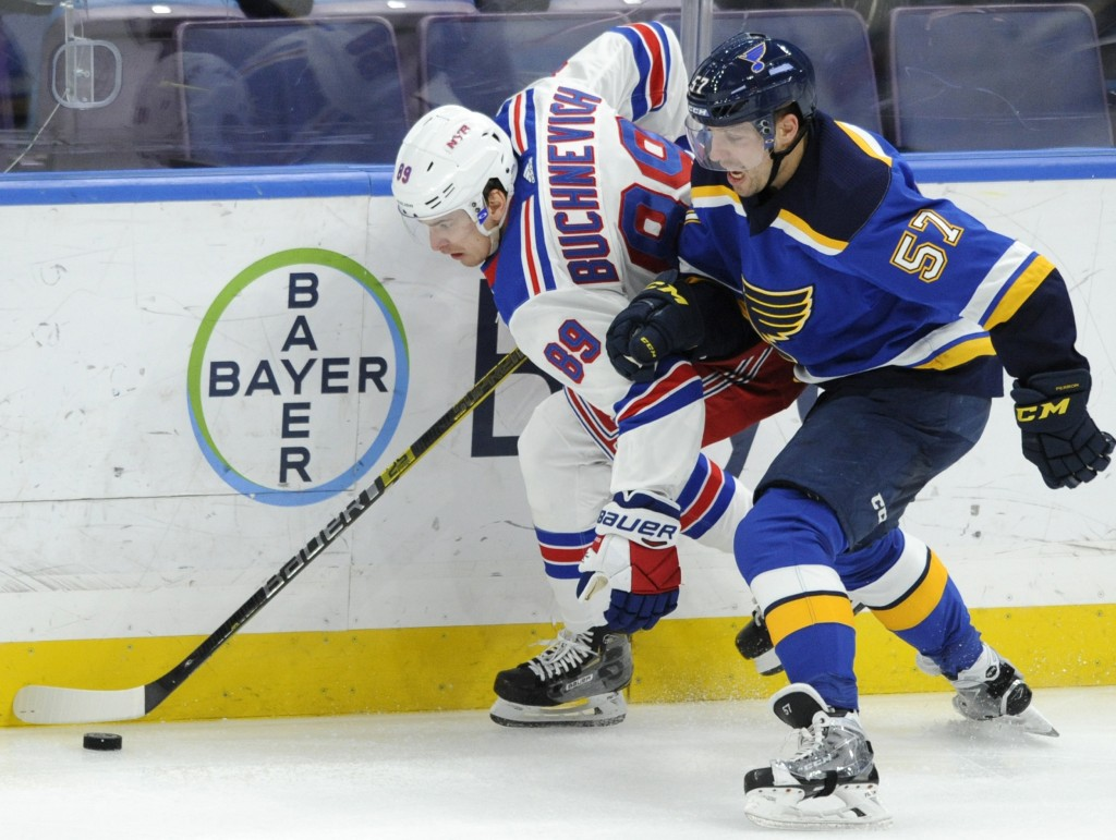 New York Rangers' Pavel Buchnevich (89), of Russia, and St. Louis Blues' David Perron (57) compete for the puck during the second period of an NHL hoc
