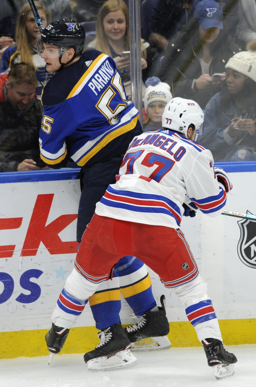 St. Louis Blues' Colton Parayko (55) is checked by New York Rangers' Tony DeAngelo (77) during the first period of an NHL hockey game Monday, Dec. 31,