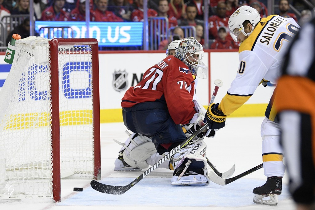 Nashville Predators right wing Miikka Salomaki (20), of Finland, scores a goal against Washington Capitals goaltender Braden Holtby (70) during the se