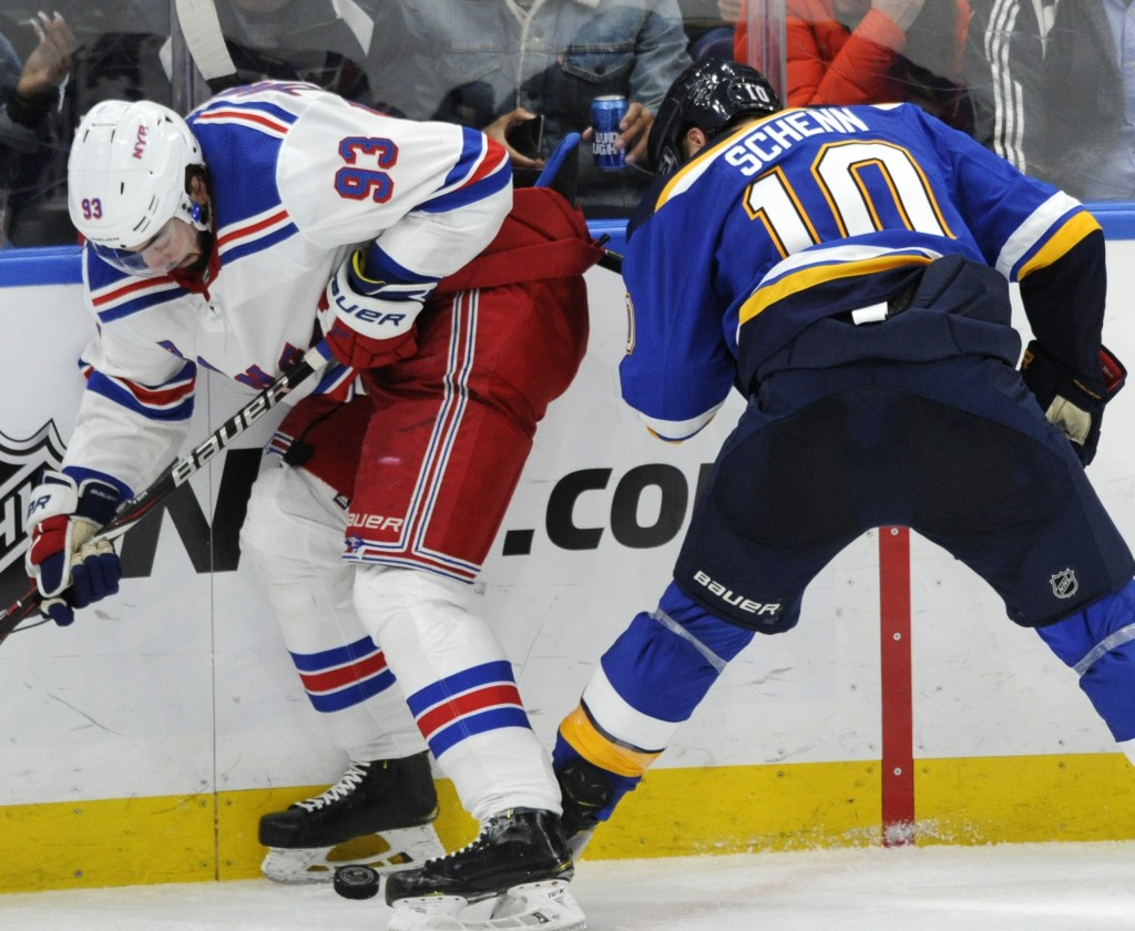 St. Louis Blues' Brayden Schenn (10) works for the puck against New York Rangers' Mika Zibanejad (93), of Sweden, during the third period of an NHL ho