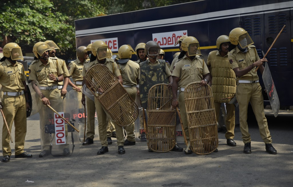 Policemen take position outside the state secretariat anticipating protests following reports of two women of menstruating age entering the Sabarimala