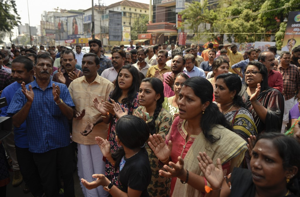 Hindus chant devotional songs during a protest against reports of two women of menstruating age entering the Sabarimala temple, one of the world's lar
