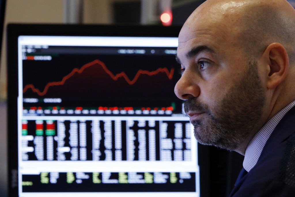 Trader Fred DeMarco works in a booth on the floor of the New York Stock Exchange, Wednesday, Jan. 2, 2019. Stock markets started the new year with a t...