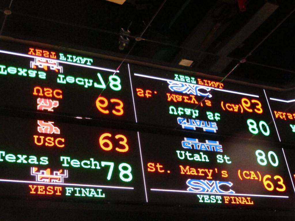 FILE This Nov. 20, 2018 file photo shows a scrolling video board with basketball scores reflected in the ceiling of the new sports book at Resorts Cas...