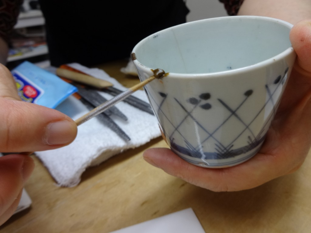 This Nov. 11, 2018 photo shows the first step in the traditional method of Kintsugi where a chip is filled in with layers of plant resin at the Kuge C