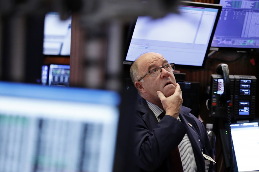 Trader Frederick Reimer works on the floor of the New York Stock Exchange, Wednesday, Jan. 2, 2019. Stock markets started the new year with a tumble, ...