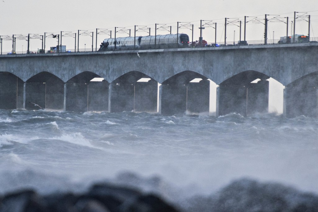 A train is stationary on the Storebaelt bridge, near Nyborg in Denmark, Wednesday, Jan. 2, 2019 after a train accident. Danish police say several peop