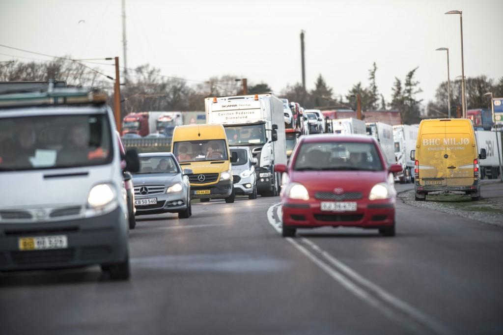 Traffic is backlogged on a road leading to the Storebaelt bridge, near Nyborg in Denmark, Wednesday, Jan. 2, 2019. Danish police say several people ha