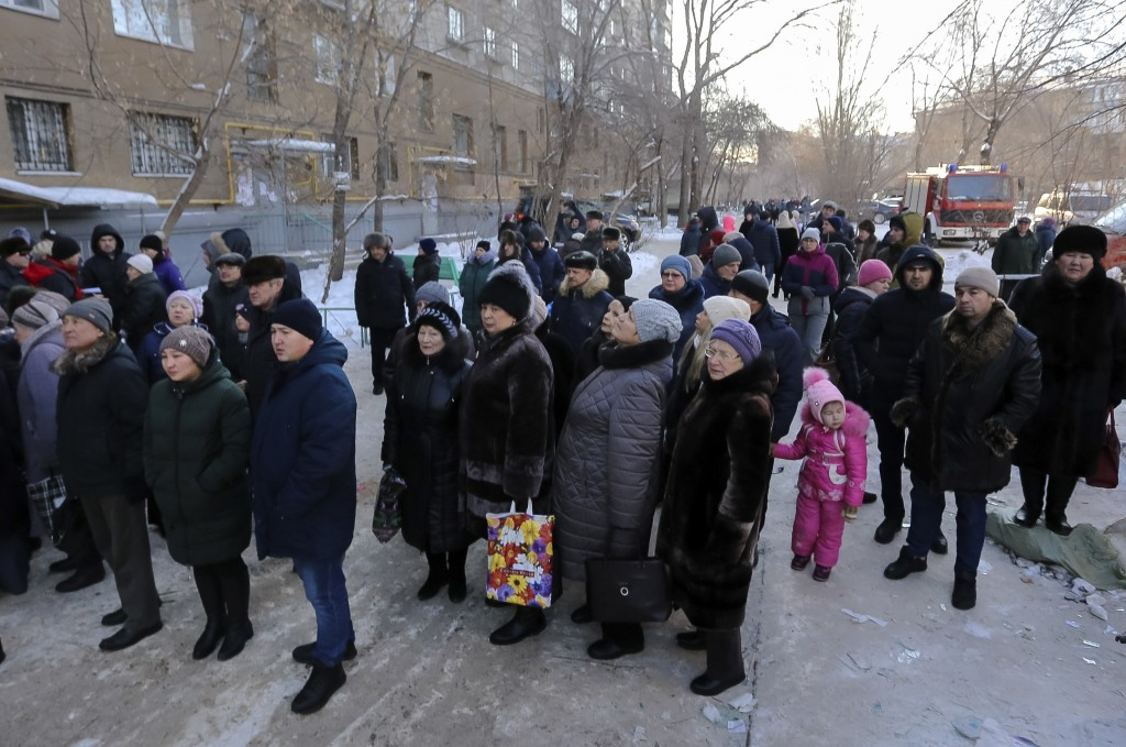 Locals gathered at the scene of the collapsed apartment building in Magnitogorsk, a city of 400,000 people, about 1,400 kilometers (870 miles) southea...