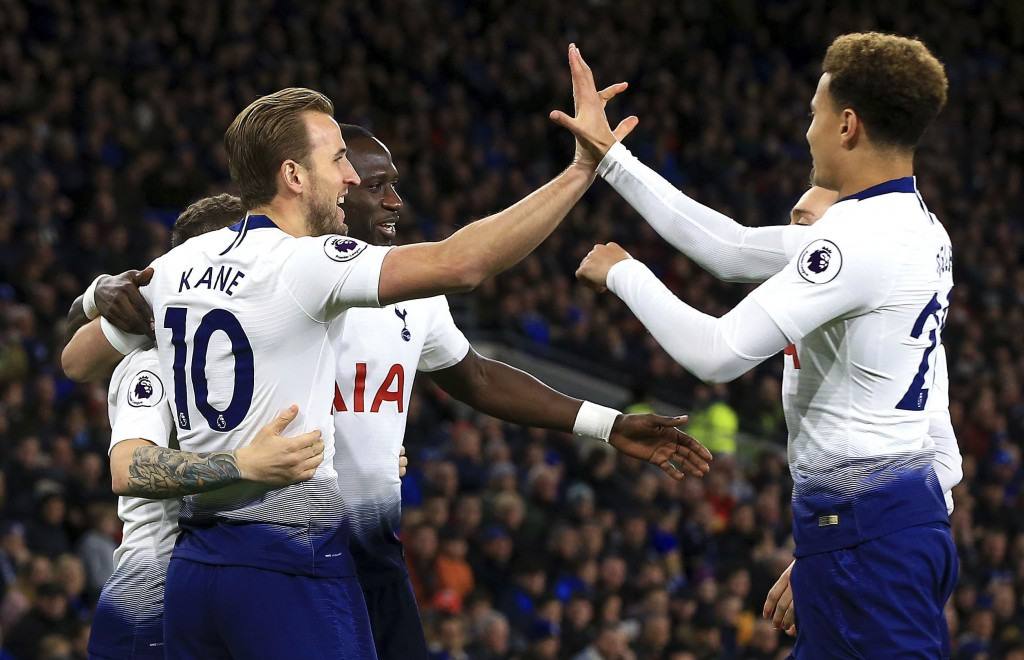 Tottenham Hotspur's Harry Kane left celebrates with teammates after scoring his side's first goal of the game against Cardiff during their English