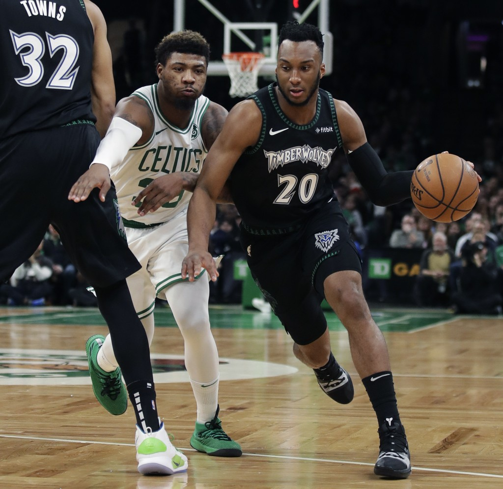 Boston Celtics guard Marcus Smart, left, chases Minnesota Timberwolves guard Josh Okogie (20) during the first quarter of an NBA basketball game in Bo