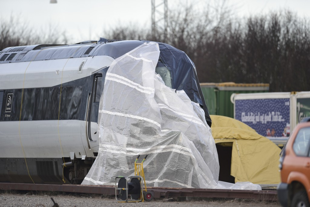 The train involved in the Wednesday morning accident is covered in Nyborg, Denmark, Thursday Jan. 3, 2019. Two more bodies have been found in the wrec