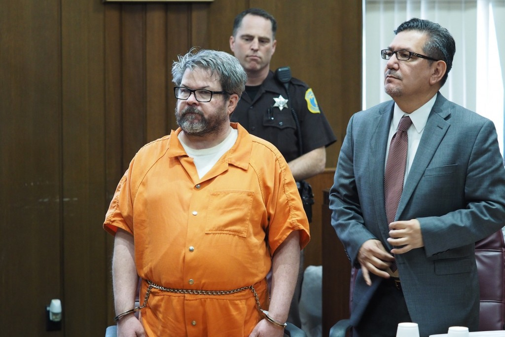 FILE - In this April 20, 2017 file photo, defendant Jason Dalton, left, who is charged with killing six people in-between picking up riders for Uber, ...