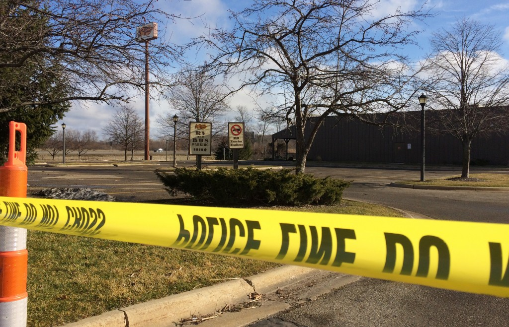 FILE - In this Sunday, Feb. 21, 2016 file photo, police tape surrounds the area of a random shooting in Kalamazoo, Mich. The jury selection process is...