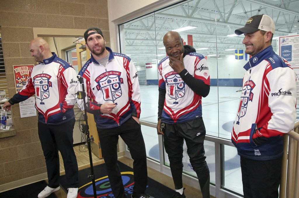 In this Jan. 3, 2019 photo, former Minnesota Vikings football player Jared Allen, second from left, stands with his three curling teammates, from left