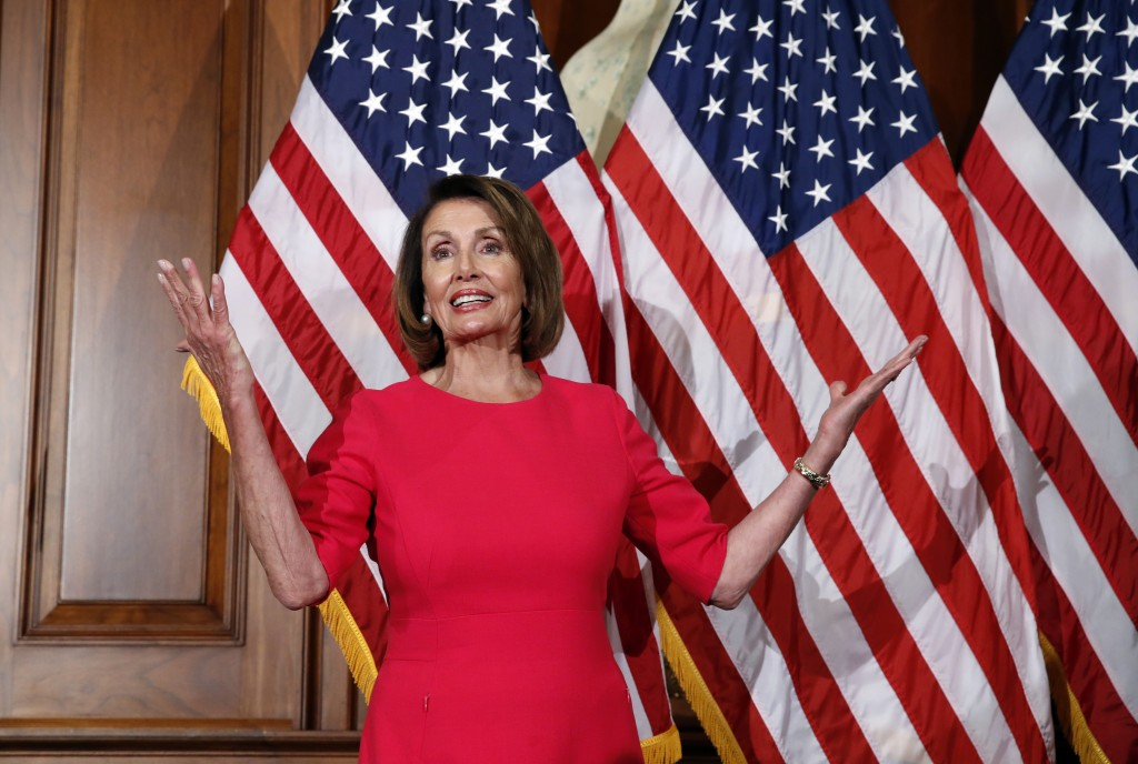 In this Jan. 3, 2019, photo, House Speaker Nancy Pelosi of Calif., gestures before a ceremonial swearing-in on Capitol Hill in Washington, during the