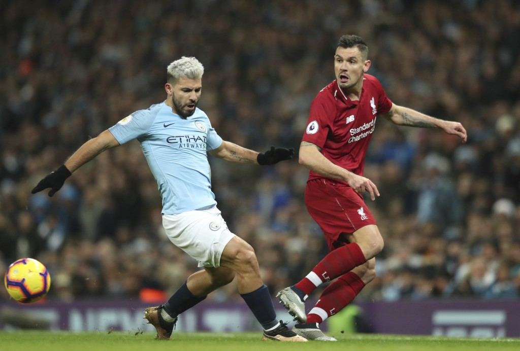 Liverpool's Dejan Lovren, right gets the ball away from Manchester City's Sergio Aguero during their English Premier League soccer match between Manch
